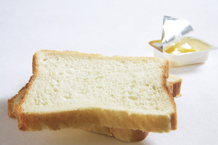 Breakfast,bread and butter on white background
