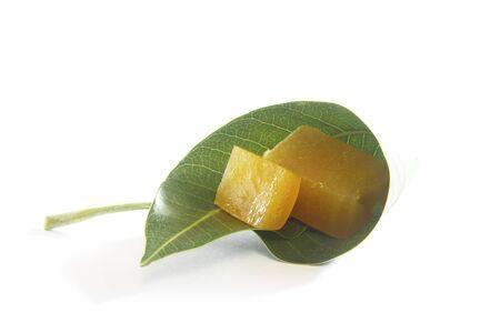 Indian cuisine ambapali or amavat dried juice of mangoes in form of flat sheet folded in mango leaf