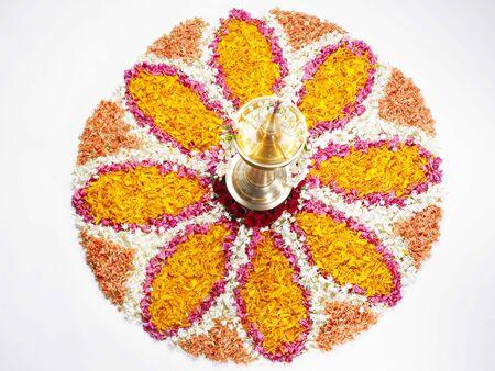 Onam Kerala festival,diya with flower design Stock Photo