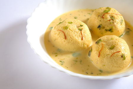 spongy: Indian sweet,kesar rasmalai garnish with pistachio and saffron served in bowl