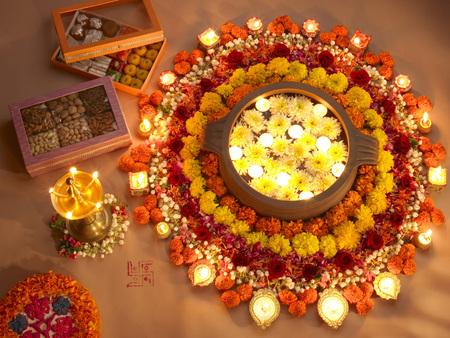Diyas and flowers arrangement for Diwali festival of lights