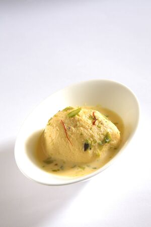 Indian sweet,kesar rasmalai garnish with pistachio and saffron served in bowl