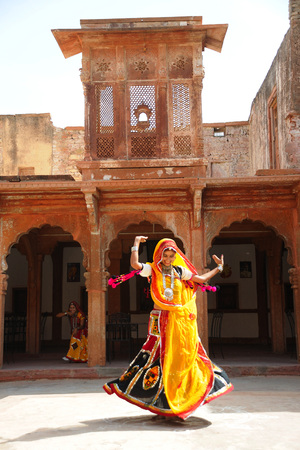 Rajasthani woman performing ghoomer dance in haveli,Rajasthan,India