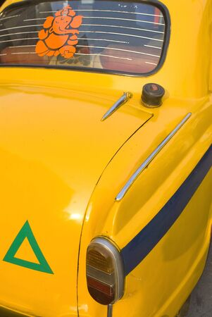 Yellow ambassador taxi at petrol pump,Bhowanipur,Calcutta,West Bengal,India