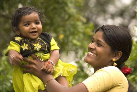 Lady and baby girl in Salunkwadi,Ambajogai,Maharashtra,India Stock Photo