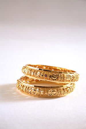 Concept,kangan gold bangle worn on wrist on white background