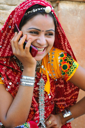 Rajasthani lady talking on mobile,Rajasthan,India Stock Photo