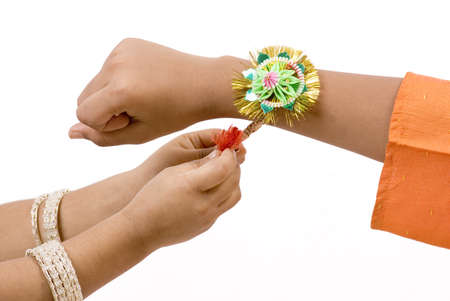 Concept,sister tying rakhi on hand of brother on Rakshabandhan festival Stock Photo