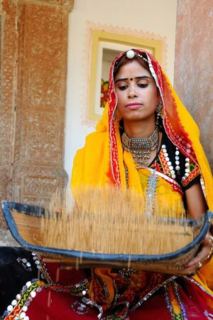 Rajasthani lady sieving wheat grain,Rajasthan,India