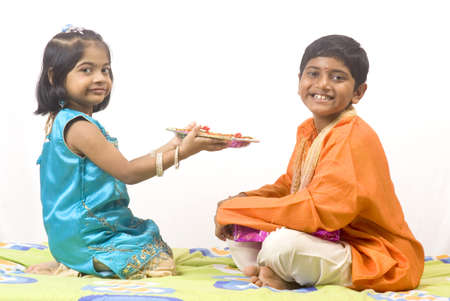 Sister holding aarti thali in front of brother on Rakshabandhan festival Stock Photo