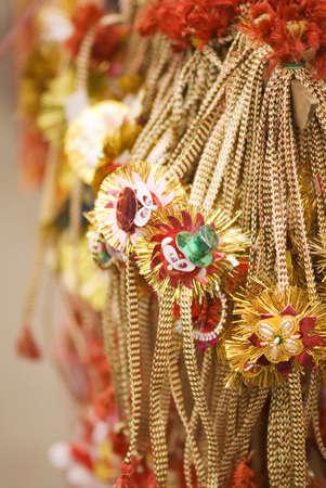Concept,bunch of multi hued rakhis tie of guarding silk string for sale on Rakshabandhan festival