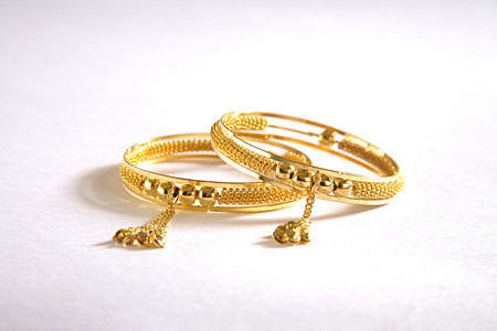 Concept,kangan gold bangle worn on wrist on white background