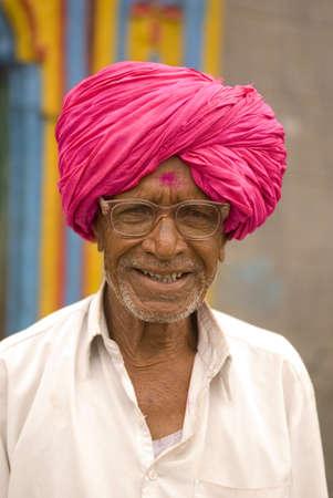 Farmer in pink turban and spectacles in Salunkwadi,Ambajogai,Maharashtra,India Stock Photo