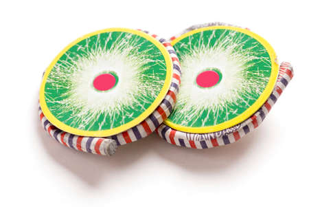 Colourful swirl crackers filled with fireworks called bhuaichakra on white background Stock Photo
