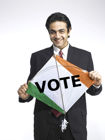 Executive holding kite shape national flag of India printed vote in English