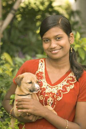 Fifteen year old girl with puppy,Parli,Vaijanath,Beed,Maharashtra,India
