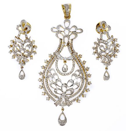 Diamond with gold jewellery pendent with ear tops on white background