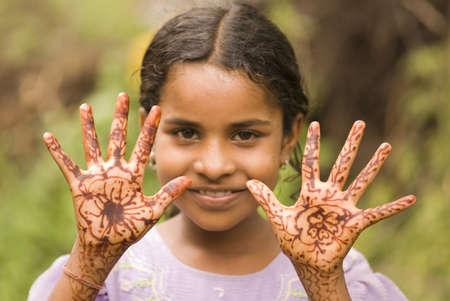 Ten year old girl showing mehendi design on both hand palms in Salunkwadi,Ambajogai,Maharashtra,India