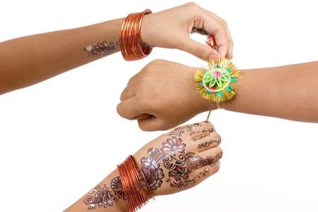 Concept,sister tying rakhi on hand of brother on Rakshabandhan festival Stock Photo