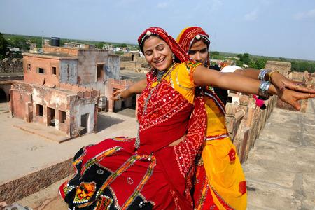 Rajasthani ladies embracing each other,Rajasthan,India LANG_EVOIMAGES