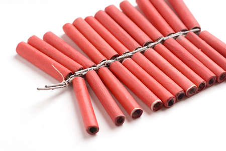 One string of red color crackers fireworks called lal fataki lad on white background