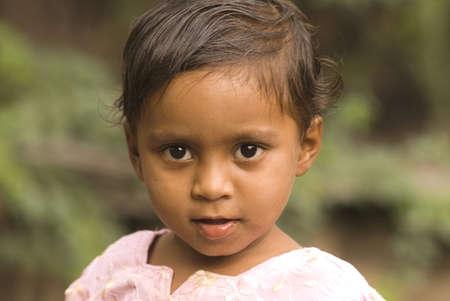 Three year old baby girl looking curiously in Salunkwadi,Ambajogai,Maharashtra,India