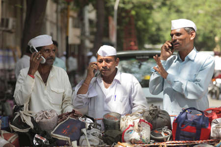 Indian dabbawala dabbawalla tiffin carrier talking on mobile at work of providing lunch boxesBombay  sc 1 st  123RF Stock Photos & Indian Dabbawala Dabbawalla Tiffin Carrier At Work Of Providing ... Aboutintivar.Com