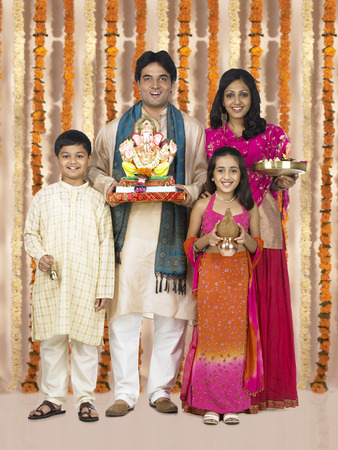 Parents with children celebrating ganesh chaturthi Stock Photo