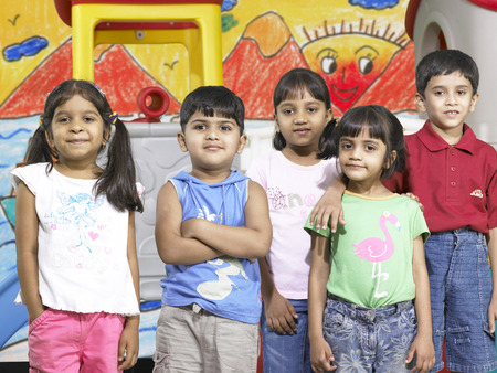 South Asian Indian boys and girls standing together in nursery school Foto de archivo