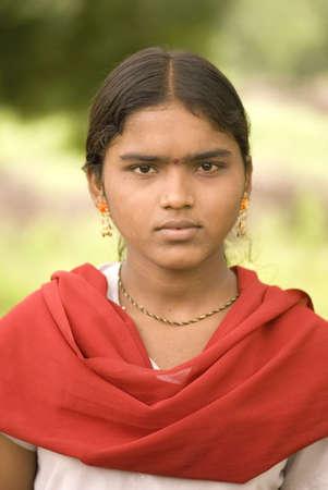 Rural girl in white top and red dupatta,village Vaitagvadi,Parbhani,Maharashtra,India