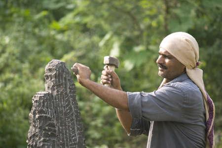 Artist sculpturing giving life to dead stone,village Daundwadi,Taluka Parli,Vajanath,District Beed,Maharashtra,India Stock Photo