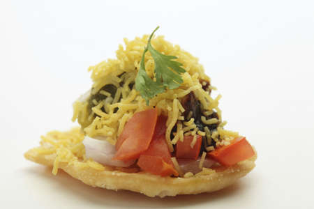 sev: Fast food,chat chaat sev puri toppings of chutney tomato onion and sev on white background