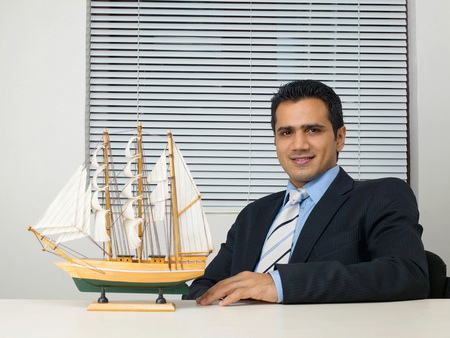 Executive with ship on desk Reklamní fotografie