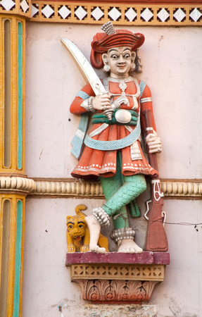 Sculpture of a dwarpal on the main gate of swaminarayan temple,Ahmedabad,Gujarat,India Reklamní fotografie