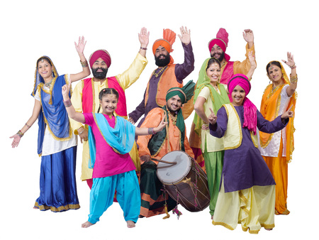 Dancers with sikh family performing folk dance bhangra Stock Photo
