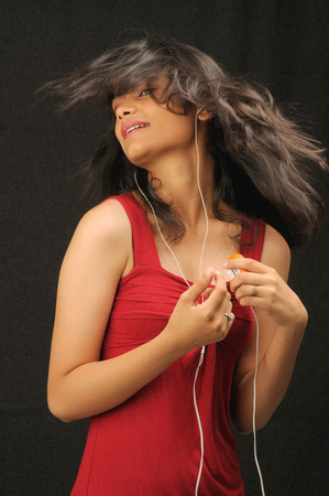 Teenager girl enjoying listening to music with ipod