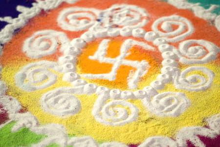 Rangoli with swastik on diwali deepawali festival Stock Photo
