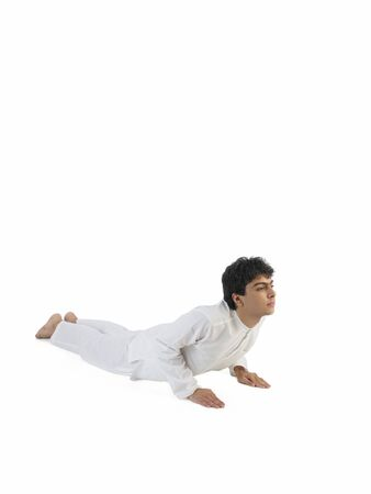 Boy practicing bhujang asana