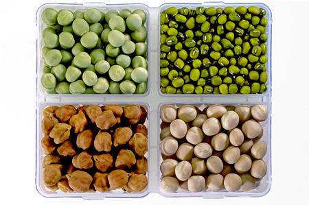 Pulses green-peas green-gram black-chickpeas and white-peas in square dish,India