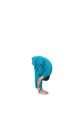Boy practicing uttana asana