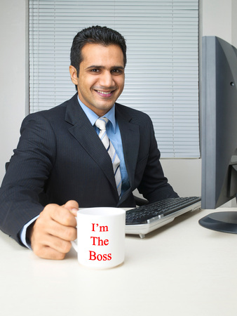 Multitasking executive holding mug