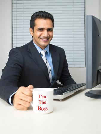 Multitasking executive holding mug