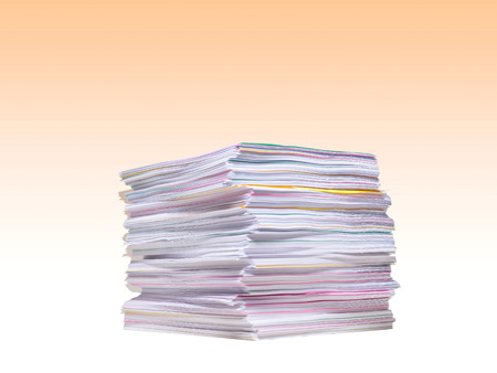 Stack of sheets of paper on white background