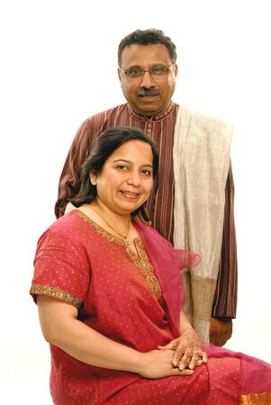 Middleage man and woman looking at camera