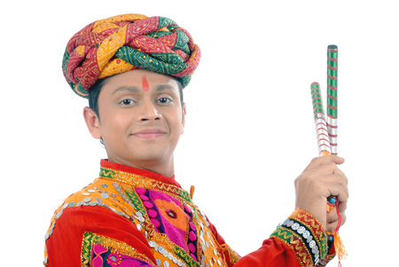 Rajasthani man playing dandiya