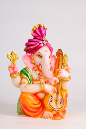 gods: Statue of lord ganesh playing veena,India LANG_EVOIMAGES