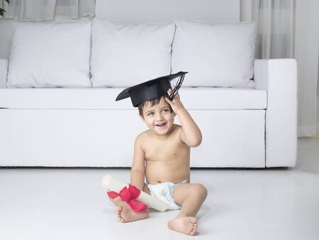 Baby holding degree certificate