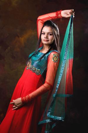 Lady in designer kurta holding dupatta