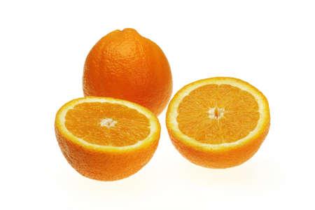One full orange and two cut pieces citrus reticulata clementin rutaceae,India
