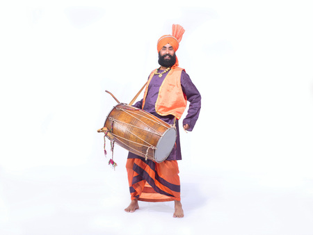 Dancer playing musical instrument dholak in folk dance bhangra Stock Photo